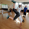 "Instructor Luis Carlos Silva, helps student, Courtney Holden, with her technique.<br /> Luis Carlos A. Silva, also known as Mestre Lucas Corvo ( Lucas the Crow), teaches Capoeira classes.<br /> For more photos and a video of Capoeira, go to  <a href=""http://www.dailycamera.com"">http://www.dailycamera.com</a><br /> Cliff Grassmick / June 16, 2011"
