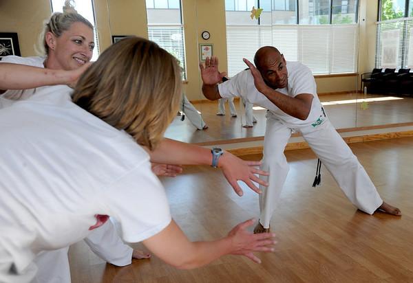 "Luis Carlos A. Silva, also known as Mestre Lucas Corvo ( Lucas the Crow), right, teaches Capoeira classes.<br /> For more photos and a video of Capoeira, go to  <a href=""http://www.dailycamera.com"">http://www.dailycamera.com</a><br /> Cliff Grassmick / June 16, 2011"