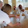 "Luis Carlos A. Silva, also known as Mestre Lucas Corvo ( Lucas the Crow), right, teaches Capoeira classes.<br /> For more photos and a video of Capoeira, go to  <a href=""http://www.dailycamera.com"">http://www.dailycamera.com</a><br /> Cliff Grassmick / June 16, 2011"