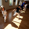 "Nico Lopez, 5, left, and Maecelo Reyes, 7, are two of the younger members of the class.<br /> Luis Carlos A. Silva, also known as Mestre Lucas Corvo ( Lucas the Crow), teaches Capoeira classes.<br /> For more photos and a video of Capoeira, go to  <a href=""http://www.dailycamera.com"">http://www.dailycamera.com</a><br /> Cliff Grassmick / June 16, 2011"
