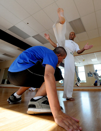 "Instructor, Luis Carlos Silva, kicks around J.B. Higdon, one of his students.<br /> Luis Carlos A. Silva, also known as Mestre Lucas Corvo ( Lucas the Crow), teaches Capoeira classes.<br /> For more photos and a video of Capoeira, go to  <a href=""http://www.dailycamera.com"">http://www.dailycamera.com</a><br /> Cliff Grassmick / June 16, 2011"