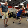 """Fitness coach, Matt Hoskins, left, works with Simon Martin on a workout routine. Martin is the Masters cross country world champion.<br />  Cheetahfit  training exercises are based on the natural evolution of human movement. <br /> For a video and more photos from the workout, go to  <a href=""""http://www.dailycamer.com"""">http://www.dailycamer.com</a>.<br /> Cliff Grassmick / August 25, 2011"""