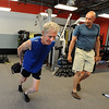 """Fitness coach, Matt Hoskins, right,  works with Simon Martin on a workout routine. Martin is the Masters cross country world champion.<br />  Cheetahfit  training exercises are based on the natural evolution of human movement. <br /> For a video and more photos from the workout, go to  <a href=""""http://www.dailycamer.com"""">http://www.dailycamer.com</a>.<br /> Cliff Grassmick / August 25, 2011"""