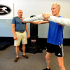 "Fitness coach, Matt Hoskins, left, works with Simon Martin on a workout routine. Martin is the Masters cross country world champion.<br />  Cheetahfit  training exercises are based on the natural evolution of human movement. <br /> For a video and more photos from the workout, go to  <a href=""http://www.dailycamer.com"">http://www.dailycamer.com</a>.<br /> Cliff Grassmick / August 25, 2011"