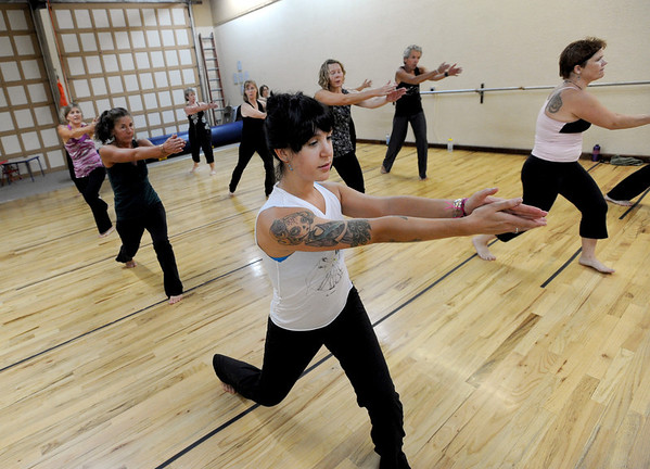 "Marisa Copeland, center, workouts out in a Boulder Nia class taught by Jill Factor.<br /> Jill Factor teaches ""Classic Nia"" which means the Nia routines that are created by Nia Co-trainers Carlos and Debbie Rosas.<br /> Factor uses Nia music and Nia choreography. The classes are balanced in 5 sensations, flexibility- agility-mobility-strength and stability.<br /> For a video and more photos of the Nia workout, go to  <a href=""http://www.dailycamera.com"">http://www.dailycamera.com</a>.<br /> Cliff Grassmick  / August 2, 2012"