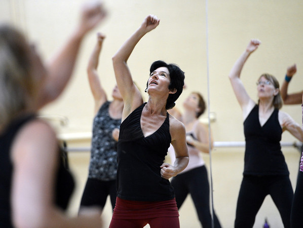 """Jill Factor, center, teaches """"Classic Nia"""" which means the Nia routines that are created by Nia Co-trainers Carlos and Debbie Rosas.<br /> Factor uses Nia music and Nia choreography. The classes are balanced in 5 sensations, flexibility- agility-mobility-strength and stability.<br /> For a video and more photos of the Nia workout, go to  <a href=""""http://www.dailycamera.com"""">http://www.dailycamera.com</a>.<br /> Cliff Grassmick  / August 2, 2012"""