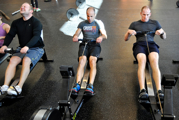 """Owner of Crossfit Sanitas Eric Roza, center, and employee Nik Lehnert, right, workout at Crossfit Sanitas in Boulder on Monday Feb. 18, 2013. DAILY CAMERA/ JESSICA CUNEO. <br /> To watch a video and see more photos go to  <a href=""""http://www.dailycamera.com"""">http://www.dailycamera.com</a>."""
