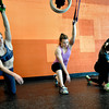 "Faye Stech, left, Kendra Lee, and Melissa Roza stretch at Crossfit Sanitas in Boulder on Monday Feb. 18, 2013. DAILY CAMERA/ JESSICA CUNEO. <br /> To watch a video and see more photos go to  <a href=""http://www.dailycamera.com"">http://www.dailycamera.com</a>."