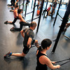 "Eric Roza, second from front, Faye Stech, left, and Kendra Lee stretch after working out at Crossfit Sanitas in Boulder on Monday Feb. 18, 2013. DAILY CAMERA/ JESSICA CUNEO. <br /> To watch a video and see more photos go to  <a href=""http://www.dailycamera.com"">http://www.dailycamera.com</a>."