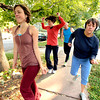 """Lindsay Sworski, left, leads Deb Silver, Roger Wolsey and Heather Kuhn  during a dance walking session through downtown Boulder  on Wednesday September 19, 2012. <br /> For more photos of the Dancewalk go to  <a href=""""http://www.daiycamera.com"""">http://www.daiycamera.com</a><br /> Photo by Paul Aiken"""