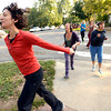 """From left to right Deb Silver leads Bree Golem and Heather Kuhn at right during a dance walking session through downtown Boulder  on Wednesday September 19, 2012. <br /> For more photos of the Dancewalk go to  <a href=""""http://www.daiycamera.com"""">http://www.daiycamera.com</a><br /> Photo by Paul Aiken"""