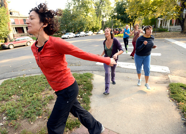 "From left to right Deb Silver leads Bree Golem and Heather Kuhn at right during a dance walking session through downtown Boulder  on Wednesday September 19, 2012. <br /> For more photos of the Dancewalk go to  <a href=""http://www.daiycamera.com"">http://www.daiycamera.com</a><br /> Photo by Paul Aiken"