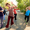 """Bree Golem, left,  and Lindsay Sworski, front right,  lead Heather Kuhn, Deb Silver and Roger Wolsey at right, during a dance walking session through downtown Boulder  on Wednesday September 19, 2012. <br /> For more photos of the Dancewalk go to  <a href=""""http://www.daiycamera.com"""">http://www.daiycamera.com</a><br /> Photo by Paul Aiken"""
