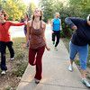 """From left to right Deb Silver, Bree Golem, Lindsay Sworski, Roger Wolsey and Heather Kuhn  during a dance walking session through downtown Boulder  on Wednesday September 19, 2012. <br /> For more photos of the Dancewalk go to  <a href=""""http://www.daiycamera.com"""">http://www.daiycamera.com</a><br /> Photo by Paul Aiken"""