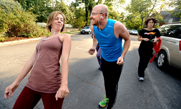 "Lindsay Sworski, jokes with Roger Wolsey during a dance walking session through downtown Boulder  on Wednesday September 19, 2012. <br /> For more photos of the Dancewalk go to  <a href=""http://www.daiycamera.com"">http://www.daiycamera.com</a><br /> Photo by Paul Aiken"