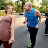 """Lindsay Sworski, jokes with Roger Wolsey during a dance walking session through downtown Boulder  on Wednesday September 19, 2012. <br /> For more photos of the Dancewalk go to  <a href=""""http://www.daiycamera.com"""">http://www.daiycamera.com</a><br /> Photo by Paul Aiken"""