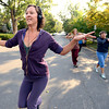 """Bree Golem, left, moves out from of Lindsay Sworski, Heather Kuhn and Deb Silver at right, during a dance walking session through downtown Boulder  on Wednesday September 19, 2012. <br /> For more photos of the Dancewalk go to  <a href=""""http://www.daiycamera.com"""">http://www.daiycamera.com</a><br /> Photo by Paul Aiken"""