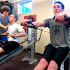 "Tristan Plank, at left and Dusty Johnson execute presses on an incline bench during a workout in the Force of Gravity strength training class at the Boulder Center for Sports Medicine on Tuesday March 16, 2010.<br /> Instructor Adam St.Pierre adjusts Plank's form.<br /> For more photos go to  <a href=""http://www.dailycamera.com"">http://www.dailycamera.com</a>. For more photos go to  <a href=""http://www.dailycamera.com"">http://www.dailycamera.com</a><br /> Photos by Paul Aiken / The Camera /"