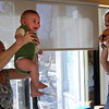 """Angela Laino, left, lifts her son, Ty, while, Gillian and Casey Jones, do the same lifting motion.<br /> Katie Wise teaches Family Yoga at Yo Mama Yoga in Boulder.<br /> For more photos and a video of the class, go to  <a href=""""http://www.dailycamera.com"""">http://www.dailycamera.com</a>.<br /> Cliff Grassmick/ March 19, 2011"""