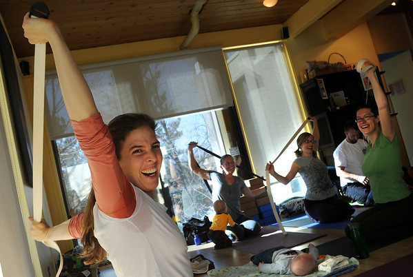 """Katie Wise, left,  teaches Family Yoga at Yo Mama Yoga in Boulder.<br /> For more photos and a video of the class, go to  <a href=""""http://www.dailycamera.com"""">http://www.dailycamera.com</a>.<br /> Cliff Grassmick/ March 19, 2011"""