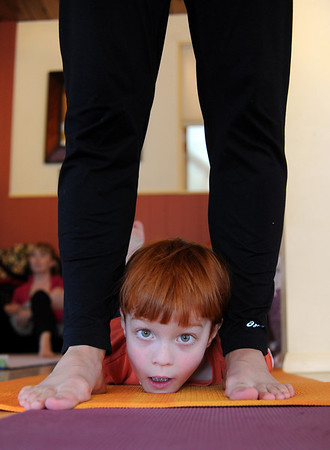 "Ian Weich finds a safe place to do yoga with his mom, Jenny.<br /> Katie Wise teaches Family Yoga at Yo Mama Yoga in Boulder.<br /> For more photos and a video of the class, go to  <a href=""http://www.dailycamera.com"">http://www.dailycamera.com</a>.<br /> Cliff Grassmick/ March 19, 2011"
