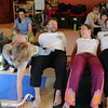 "Katie Wise, third from the right, gets the group to form a tunnel after completing the yoga train. Two moms can do this an nurse at the same time.<br /> Katie Wise teaches Family Yoga at Yo Mama Yoga in Boulder.<br /> For more photos and a video of the class, go to  <a href=""http://www.dailycamera.com"">http://www.dailycamera.com</a>.<br /> Cliff Grassmick/ March 19, 2011"