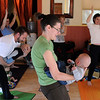 """Angi Harding, center, does a yoga pose with he son, Owen.<br /> Katie Wise teaches Family Yoga at Yo Mama Yoga in Boulder.<br /> For more photos and a video of the class, go to  <a href=""""http://www.dailycamera.com"""">http://www.dailycamera.com</a>.<br /> Cliff Grassmick/ March 19, 2011"""