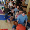 """Ian Weich, bottom, tells the yoga train the direction to stretch.<br /> Katie Wise teaches Family Yoga at Yo Mama Yoga in Boulder.<br /> For more photos and a video of the class, go to  <a href=""""http://www.dailycamera.com"""">http://www.dailycamera.com</a>.<br /> Cliff Grassmick/ March 19, 2011"""
