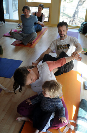 "Katie Wise talks to her son, Phoenix, while her husband, John, holds her arms.Zac and Cindy Zoet, back left, are doing the same pose.<br /> Katie Wise teaches Family Yoga at Yo Mama Yoga in Boulder.<br /> For more photos and a video of the class, go to  <a href=""http://www.dailycamera.com"">http://www.dailycamera.com</a>.<br /> Cliff Grassmick/ March 19, 2011"