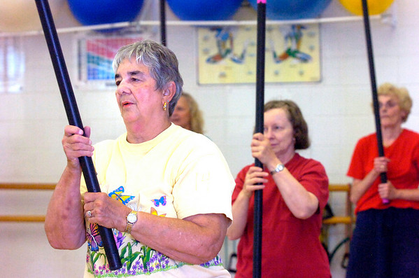 "From left to right Kitty Lewis, Patti Zarlengo and Marge Bubany use weighted bars in the Fitness for Life workout at the East Boulder Recreation Center on Tuesday August 18, 2009. Photo by Paul Aiken / The Camera / August 18, 2009<br /> VIDEO: Watch the Fitness for Life Workout at  <a href=""http://www.dailycamera.com"">http://www.dailycamera.com</a>.<br /> <br /> INLINE: FITNESS FOR LIFE WORKOUT OF THE WEEK AUGUST 2009"