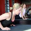 "Elizabeth Rao, of Boulder, works out her back and arms during a Fitwall workout class on Friday, Feb. 10, at the Fortis Fitness Training gym on Glenwood Drive in Boulder. For more photos and video of the class go to  <a href=""http://www.dailycamera.com"">http://www.dailycamera.com</a><br /> Jeremy Papasso/ Camera"