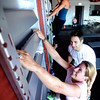 "Fortis Fitness owner and instructor Jeremiah Dargis works with Brooke Davison during a Fitwall workout class on Friday, Feb. 10, at the Fortis Fitness Training gym on Glenwood Drive in Boulder. For more photos and video of the class go to  <a href=""http://www.dailycamera.com"">http://www.dailycamera.com</a><br /> Jeremy Papasso/ Camera"