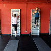 "Elizabeth Rao, left, Brooke Davison, Noelle Roshko and Patti Stricklin work out during a Fitwall workout class on Friday, Feb. 10, at the Fortis Fitness Training gym on Glenwood Drive in Boulder. For more photos and video of the class go to  <a href=""http://www.dailycamera.com"">http://www.dailycamera.com</a><br /> Jeremy Papasso/ Camera"