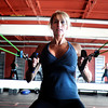 "Noelle Roshko, of Boulder, works her arms and back with bungees during a Fitwall workout class on Friday, Feb. 10, at the Fortis Fitness Training gym on Glenwood Drive in Boulder. For more photos and video of the class go to  <a href=""http://www.dailycamera.com"">http://www.dailycamera.com</a><br /> Jeremy Papasso/ Camera"
