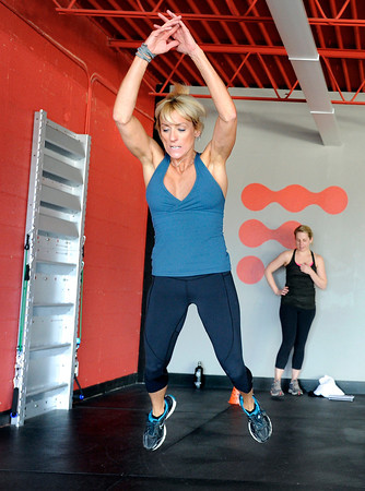 "Noelle Roshko, left, and Elizabeth Rao, both of Boulder, finish up a jumping exercise during a Fitwall workout class on Friday, Feb. 10, at the Fortis Fitness Training gym on Glenwood Drive in Boulder. For more photos and video of the class go to  <a href=""http://www.dailycamera.com"">http://www.dailycamera.com</a><br /> Jeremy Papasso/ Camera"