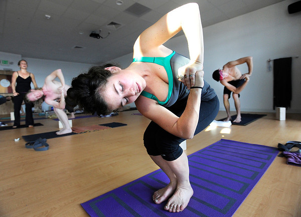 "Jessica Villanueva exercises during a Forrest Yoga class on Friday, Dec. 9, at the Yoga Pod on 29th Street in Boulder. For more photos and video of the class go to  <a href=""http://www.dailycamera.com"">http://www.dailycamera.com</a><br /> Jeremy Papasso/ Camera"