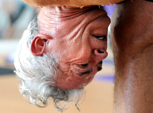 "Rogelio Pena drips sweat during a Forrest Yoga class on Friday, Dec. 9, at the Yoga Pod on 29th Street in Boulder. For more photos and video of the class go to  <a href=""http://www.dailycamera.com"">http://www.dailycamera.com</a><br /> Jeremy Papasso/ Camera"