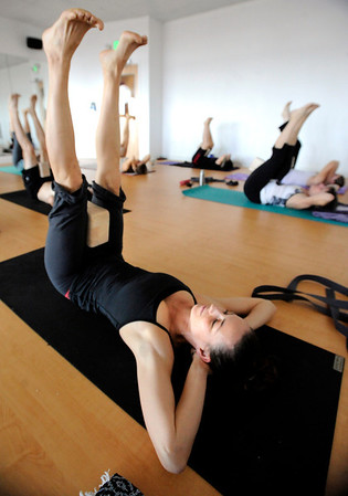 "Kirsten Warner stretches during a Forrest Yoga class on Friday, Dec. 9, at the Yoga Pod on 29th Street in Boulder. For more photos and video of the class go to  <a href=""http://www.dailycamera.com"">http://www.dailycamera.com</a><br /> Jeremy Papasso/ Camera"