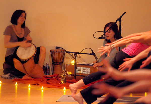 Sally Spear, left, and Sally Spear, right, plays live music during Friday Night Yoga Club at Yoga Pod in Boulder on Friday, Feb. 17, 2012. This Class is part of a growing trend were live music is part of the work out. <br /> Photo by Derek Broussard