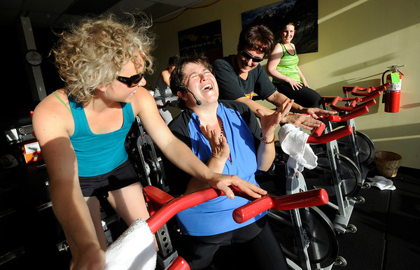 Instructor Peggy Dyer sings with Ali Schutz, at left,  during the Guilty Pleasures w/Peggy class at the Mountain's Edge Fitness Center.<br /> Photo by Paul Aiken  August 8, 2011.