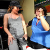 Charlotte Kelly, left, takes over the microphone from Instructor Peggy Dyer, during the Guilty Pleasures w/Peggy class at the Mountain's Edge Fitness Center.<br /> Photo by Paul Aiken  August 8, 2011.