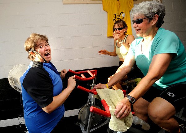 Instructor Peggy Dyer, left, belts out a tune with Jan Lippard, and JoAnn Silverstein, at right, during the Guilty Pleasures w/Peggy class at the Mountain's Edge Fitness Center.<br /> Photo by Paul Aiken  August 8, 2011.