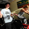 C.J. Carter, left and Charlotte Kelly sing as the pedal during the Guilty Pleasures w/Peggy class at the Mountain's Edge Fitness Center.<br /> Photo by Paul Aiken  August 8, 2011.