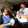 Instructor Peggy Dyer, left, belts out a song with C.J. Carter as Dyer pases out water during the Guilty Pleasures w/Peggy class at the Mountain's Edge Fitness Center.<br /> Photo by Paul Aiken  August 8, 2011.