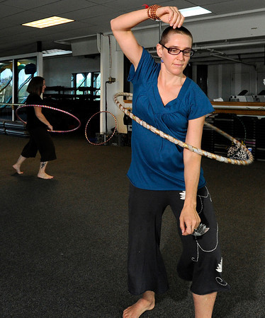 """Jennifer Jones, of Longmont, at right, works on her moves during a Hoop Dance Fitness class on Tuesday, Aug. 28, at the RallySport Health and Fitness Club in Boulder. For more photos of the workout go to  <a href=""""http://www.dailycamera.com"""">http://www.dailycamera.com</a><br /> Jeremy Papasso/ Camera"""