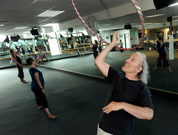 "Brad Baker, of Boulder, right, works out during a Hoop Dance Fitness class on Tuesday, Aug. 28, at the RallySport Health and Fitness Club in Boulder. For more photos of the workout go to  <a href=""http://www.dailycamera.com"">http://www.dailycamera.com</a><br /> Jeremy Papasso/ Camera"
