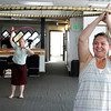 "Becky Landkammer, of Boulder, right, and Juliette Nelson, of Boulder, laugh as they work on their moves during a Hoop Dance Fitness class on Tuesday, Aug. 28, at the RallySport Health and Fitness Club in Boulder. For more photos of the workout go to  <a href=""http://www.dailycamera.com"">http://www.dailycamera.com</a><br /> Jeremy Papasso/ Camera"