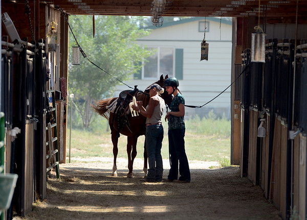 "Sarah Brock, right, and Peggy Arguello get Karma the horse ready for riding at Gateways to Transformation Farm in Longmont.<br /> For more photos and a video of riding, go to  <a href=""http://www.dailycamera.com"">http://www.dailycamera.com</a>.<br /> Cliff Grassmick  / August 31, 2012"