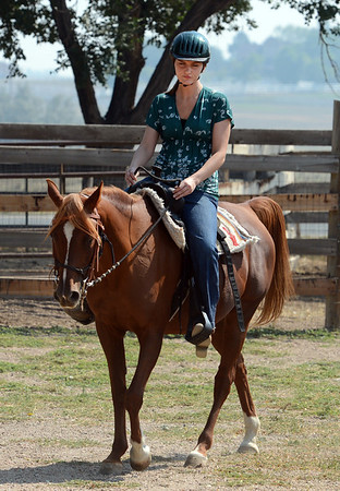 """Sarah Brock rides Karma the horse at Gateways to Transformation Farm in Longmont.<br /> For more photos and a video of riding, go to  <a href=""""http://www.dailycamera.com"""">http://www.dailycamera.com</a>.<br /> Cliff Grassmick  / August 31, 2012"""