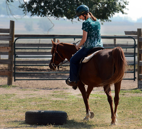 "Sarah Brock rides Karma the horse at Gateways to Transformation Farm in Longmont.<br /> For more photos and a video of riding, go to  <a href=""http://www.dailycamera.com"">http://www.dailycamera.com</a>.<br /> Cliff Grassmick  / August 31, 2012"